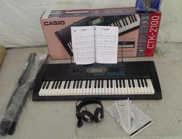 Casio CTK 2100 61 Key Portable Keyboard Package w/Headphone, Stand